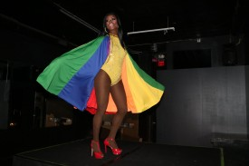 Symone Bishop shows her LGBTQ pride while dancing in a rainbow cape to commemorate Gilbert Baker who passed away on March 31st, 2017. Baker designed the rainbow pride flag in 1978.