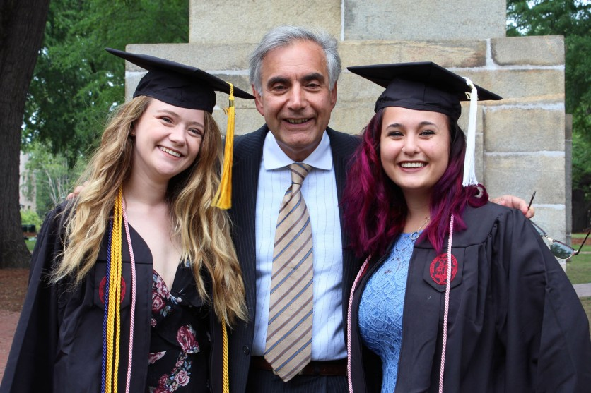 UofSC President Harris Pastides smiles with two graduating seniors on the Horseshoe.