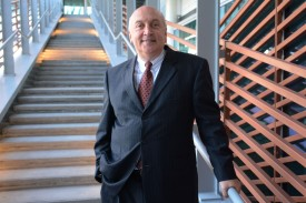 Deloitte Managing Director Vincent Mooney on the Moore School courtyard stairs.